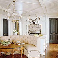Brick backsplash, ceiling, and banquette.