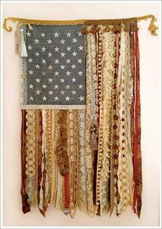 Make a flag out of old ribbons, lace and pompom fringe.