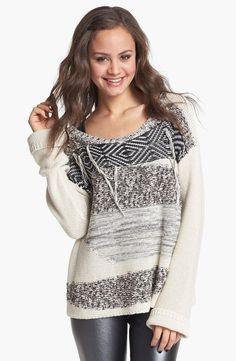 Cute n' cozy in a patterned knit sweater.