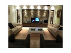 Living Room: Select focal wall and build out wall niches.  Cover back with stone tile.  Find vintage furniture bureau to house TV or create custom.... modern living rooms, tv room, living room designs, family rooms, stone walls, media room, feature walls, modern homes, accent walls