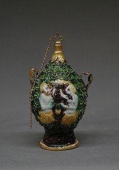 Bottle, Perfume  Workshop of Paul Preuning (active ca. 1550)  Date: second half 16th century Culture: German or Austrian (Nuremberg) (?) Medium: Maiolica (tin-enameled earthenware) with yellow metal mounts