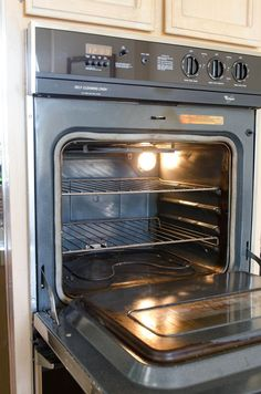 Clean an oven with vinegar and baking soda