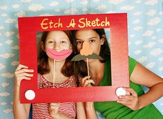 Etch-a-Sketch frame (photo mat painted red with white lids for the handles)