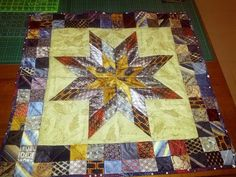 8 point star quilt top.  This a stunning looking quilt.  I like the quilter's fabric choices.  Peace, Robert from nancysfabrics.com
