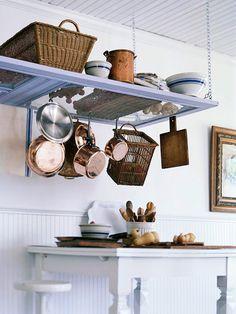 hanging pot rack made with an old screen door