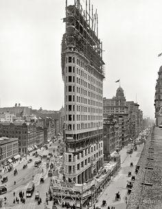 The Flatiron Building under construction in 1902