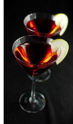 Candy Apple Martini:  1 oz apple flavored vodka**  1 oz sour apple pucker  1 oz butterscotch schnapps  4 oz cranberry juice  Garnish with apple slices