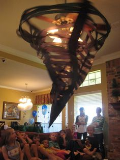 Make a tornado from your fan - that even rotates!!  Tornado Party or Wizard of Oz Party Inspiration; Wow kids and parents alike!