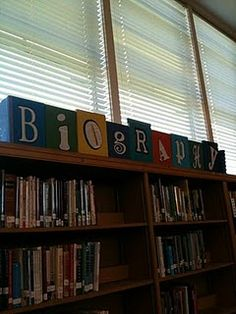 I created this sign for my library.  I used a book for each letter, cut the letter out of a book page with my Cricut and then glued all the books to a 1X4. My son screwed a book to each end to support the sign. I love it.