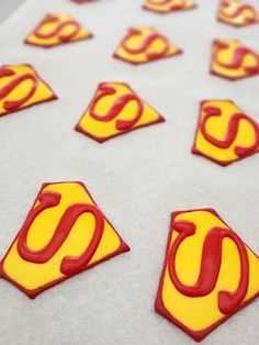 really neat super hero cupcake toppers out of Royal Icing, a definate possibility :)  Cheyenne we could probably do this. Just have to see how long they would hold. This way maybe we could make these ahead of time and just make plain, different flavor cupcakes. Then put these on top.