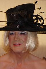 Transvesite cross dresser wearing hat