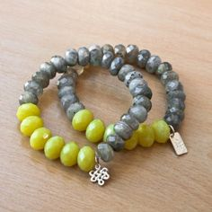 Eternal Bracelets...Labradorite rondels in an iridescent grey are combined with larger faceted olive Jade beads