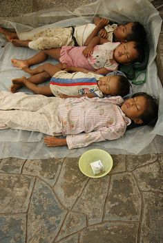 POVERTY - Udong, Cambodia. (Street children are a common feature of life in too many places in the world.)