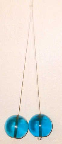 clackers Remember someone threw theirs on the power line.  Was there for years.