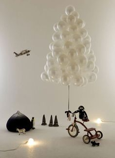 Hang balloons on the wall in the shape of a tree. | 38 Fabulous DIY Christmas Trees That Aren't Actual Trees