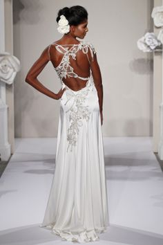 Ambiance~Distinctive Weddings and Events Pnina Tornai~This sheath gown features a v-neck neckline with a natural waist in silk charmeuse and beaded embroidery. It has a chapel train and spaghetti straps. This gown is Exclusive to Kleinfeld Bridal. For Planning help, call (410) 819-0046 MaryanJudy.com