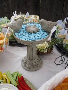 Bird's nest themed shower- some cute ideas in this one! especially the bird bath holding m lol