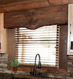 This rustic window valence can be easily made from wood.