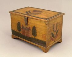 """Realized Price: $11115 Jacob Weber(1772-1865), Fivepointville, Lancaster County, Pennsylvania, dated 1850, painted pine dresser box, the lid and top with tulips on a yellow ground, the front with a brick house, trees, and lawn supported by bracket feet, 4 1/2"""" h., 7"""" w."""