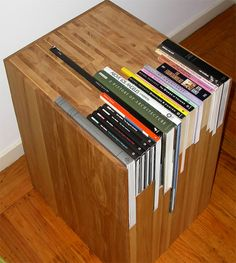 San Francisco-based furniture maker Jane Dandy creates these wooden side tables that perfectly encase your books.