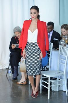 Jamie Chung in  blazer by Reese + Riley—worn with a strappy cami top by Cameo the Label and a skirt by Elizabeth and James