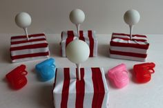 DIY ping pong squirt game activity. floral foam wrapped in paper, golf tee, ping pong ball, squirt gun=fun