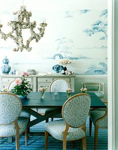 Canton porcelain inspired the dining room's mural. Chairs are covered in Scramble in Slate from Calico Corners.