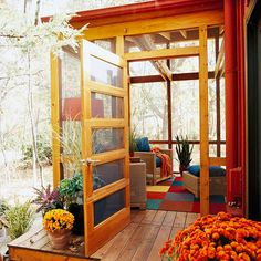 Four Square Porches needn't be large; a small screened area can provide a nice transition to either a front or back space. A five-panel door offers a rich design statement for the porch's entry.
