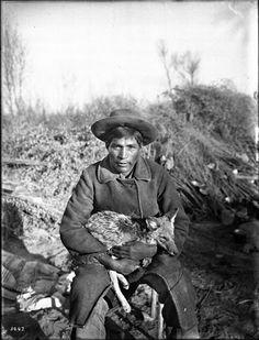 Chemehuevi man holding a pet Coyote - circa 1900