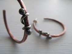 Rustic artisan mixed metal handmade hoops in copper and sterling silver by JoDeneMoneuseJewelry