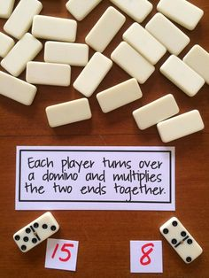 Multiplication War - after multiplying, player with larger quotient collect both dominoes---or do with addition, or make two digit numbers