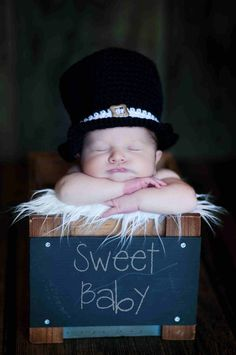 Newborn Baby Top Hat, Black Baby Hat, Photography Props Newborns. $35.00, via Etsy.
