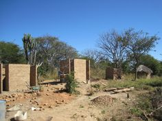 13. You can see here the 2 old crumbling latrines on the right, next to the new ones under construction - what a difference!
