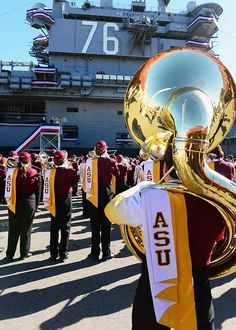 """SAN DIEGO (Dec. 29, 2013) The Arizona State University marching band performs for Sailors in front of the aircraft carrier USS Ronald Reagan (CVN 76) during a """"Battle of the Bands"""" as part of the Navy and Marine Corps Holiday Bowl Luncheon. #USNavy #AircraftCarrier #ReaganCVN76"""