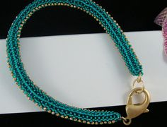 Beaded bangle with lobster clasp by Ravenmood on Etsy, $25.00