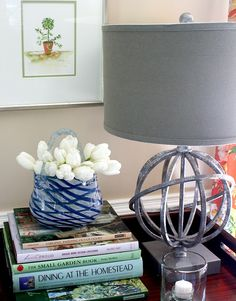 Stacked books, fresh flowers and a candle are just a few ideas for styling your side table.