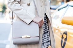 Cuyana leather shoulder bag in stone, on the lovely Grace Atwood