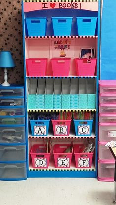SOO cute! I love all the storage and the labelled guided reading bins! classroom book bins, classroom book storage, book organization classroom, organizing books in classroom, school libraries, guided reading books, book baskets