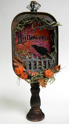 Altered tin Halloween decor