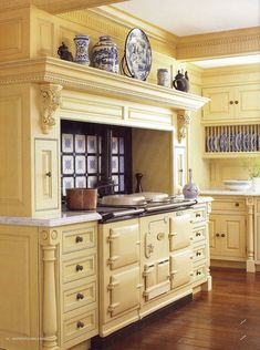 Old world oven in a soft yellow kitchen with  blue & white tile.