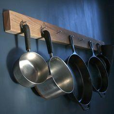 DIY-aesthetic reclaimed wood pot & pan hanging rack designed by Elsa Henderson. $35.00, via Etsy.
