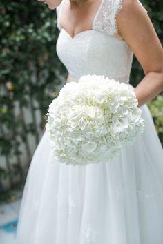 White wedding bouquet: http://www.stylemepretty.com/texas-weddings/austin/2014/07/30/elegant-austin-wedding-at-one-world-theater/ | Photography: Caroline Joy - http://carolinejoy.com/