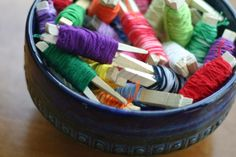 Wind your embroidery thread onto clothespins to keep it from getting tangled.