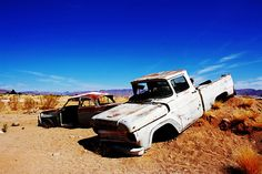 Such a cool picture. Abandoned pickup truck and car in the desert