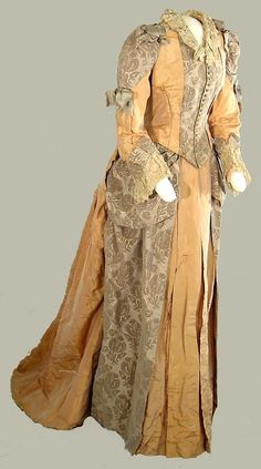 c. 1882, Two-piece formal afternoon gown of apricot and grey brocade and taffeta; lace trim at neck and cuffs; small train.