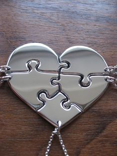 Each piece representing a family member! Heart shaped jigsaw puzzle pendants necklaces.