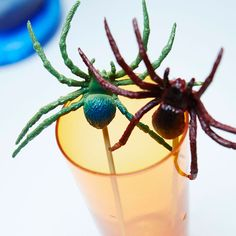It's alive! Make your guests do a double take with these creepy crawly spider skewers. Pierce rubber spiders with wooden skewers for this haunting effect. #Halloween #cocktails