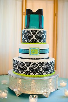 A teal, lime green and damask stunner with a fondant bow, rhinestone bands, and a monogram