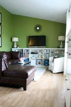 Console/bookcase - white against colored wall, with other wood in room
