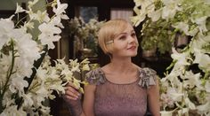 Carey Mulligan as Daisy Buchanan, Title: The Great Gatsby    Release Date: 10/05/2013    Genre: Romance / Drama    Country: USA / Australia    Director: Baz Luhrmann    Cast: Leonardo DiCaprio, Carey Mulligan, Tobey Maguire, Joel Edgerton, Isla Fisher & Jason Clarke    Studio: Village Roadshow Pictures / Distribution: Warner Bros. Pictures